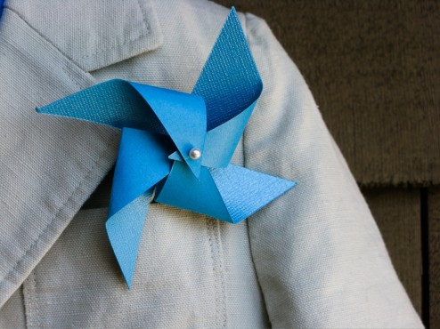 child-size blue pinwheel boutonniere close-up