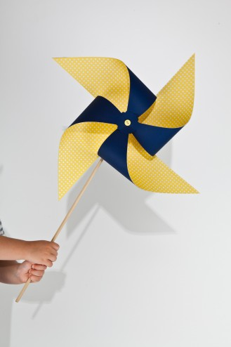 Large yellow and navy blue pinwheel on dowel