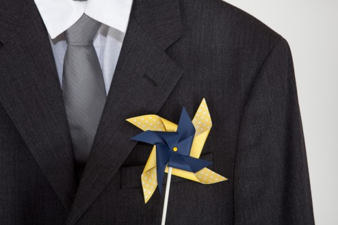 Yellow and navy adult pinwheel boutonniere